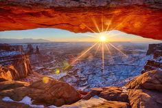 snowy-arch-canyonlands