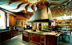 Molteni range, custom cabinetry in African mahogany, Vent-a-Hood range hood & decorative lighting/ceiling in showroom of @SalonBlueRidge near Asheville, NC