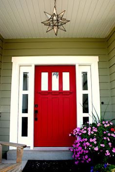 After looking at about 400 front doors over the last 2 weeks...THIS is the official final choice. Craftsman door with decorative shelf detail which we plan to paint bright red as soon as it warms up. Yay!