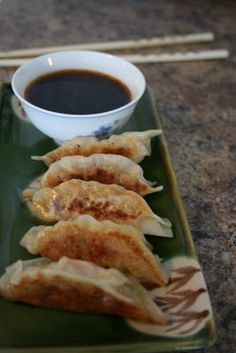 Gyoza recipe. Makes 72 dumplings (can also freeze them). Ingredients: ground pork, coleslaw, fresh giner, garlic, sugar, soy sauce, sesame oile, package of gyoza skins (Shanghai dumpling wrappers), water, and cornstarch.
