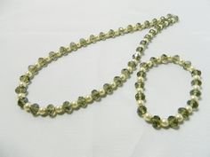 Preciosa Czech glass 6mm ivory pearls and 8mm faceted glass black diamond abacus crystals necklace with trigger clasp. Necklace length 18 inches,