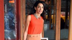 Amal Clooney is not only an accomplished human rights lawyer, but a full-blown fashion icon, and she proves it every time she steps out! PHOTOS: Amal Clooney's Best Looks The 37-year-old's latest head-turning look came on Tuesday, when she stunned in an eye-catching orange Gucci top and a matching tan belted Gucci skirt in New York City. Pairing the ensemble with a chic pair of nude heels, it's safe to say she pulled off this retro '70s look flawlessly. Splash News But just how much does…