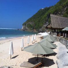 """Best Beaches - """"We love going to Finn's Beach Club in the Bukit if we want to have a day of luxury and order yummy cocktails and nibbles from the beach bar—you pay a flat day rate for a towel, sunbed and food. Balangan Beach in the Bukit has the old-school Bali vibe with huts on the beach. You can order local food from the huts on the sand and get the real Bali feel!"""""""