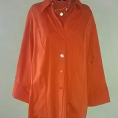 Burnt orange blouse with shell Burnt orange button down three-quarter sleeve. Mock turtleneck shell underneath. From armpit to bottom hem mesures 15 and a half inches. Size on item size 22/24. Size on sales tag size 3x. Dress Barn Tops Button Down Shirts