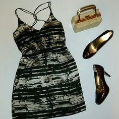Drop! Gorgeous Rumors Strappy Dress Taupe and black abstract design. V-neck with crossover straps. Elastic waist and some elastic on back to give for larger chest. 33 inch max chest. Rumors  Dresses