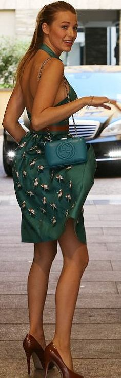 Blake Lively Gucci pumps, green print halter dress, and blue handbag