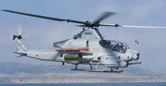 """The Bell AH-1Z Viper is a twin-engine attack helicopter based on the AH-1W SuperCobra, that was developed for the US Marine Corps. The AH-1Z features a four-blade, bearingless, composite main rotor system, uprated transmission, and a new target sighting system. The AH-1Z is part of the H-1 upgrade program. It is also called """"Zulu Cobra"""" in reference to its variant letter."""