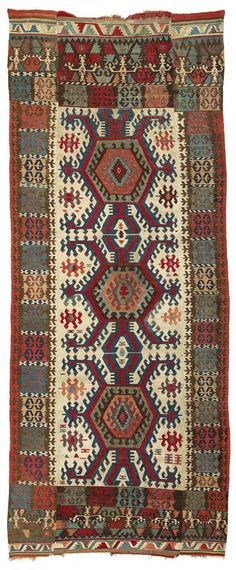 As Eskenazi assumes for a comparable example, this large, white-ground tribal kilim from the Konya region may have been woven by Afshar nomads. Turkey
