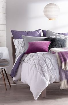 This purple bedroom will be perfect with some lavender scented candles.