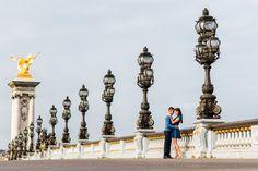 Romantic couple hugging on Alexander 3 bridge in Paris. Picture taken by award winning Paris engagement photographer Fran Boloni