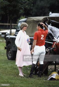 A pregnant Diana Princess of Wales and Prince Charles Prince of Wales attend a polo event at Windsor Great Park on June 1982 in Windsor England