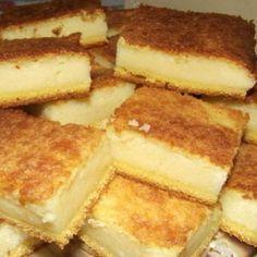 Receita de Delícia de Fubá - 3 unidades de ovo, 4 xícaras (chá) de leite, 1 1/2 xícaras (chá) de fubá, 2 xícaras (chá) de açúcar, 1 colher (sopa) de manteig...