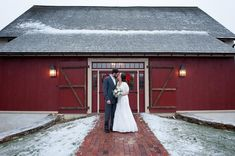 This adorable red barn makes the perfect backdrop on a snowy, wintery day in Chester County, Pennsylvania! See the entire Real Wedding held at the Brandywine Manor House on the blog! #realwedding #chestercountyweddings #paweddings #phillyweddings #cheesesteaksandsoftpretzels