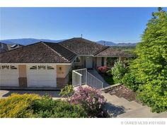 For more pictures, visit www.jennifer-black.com. Large family home boasting fabulous lake and mountain views, located on a quiet cul-de-sac, 4 bdrms, 3 bathrooms, Gourmet kitchen, vaulted ceilings, fully finished basement, large fenced yard for kids and pets.