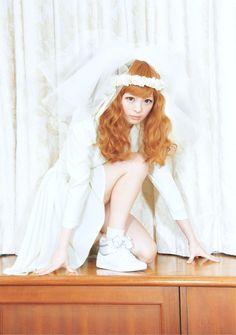 Kyary Pamyu Pamyu sporting sneakers and wedding dress