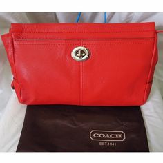 """COACH Large Wristlet ✨ Coach Park Signature Large Wristlet Color Sienna  Product Details :  Coach Park Leather Large Wristlet  Color: Silver / Sienna [Coral] Material: Leather/Silver toned hardware  Featured: Top zip closure with long leather pull. Front turnlock pocket. Lining inside. One interior slip pocket  Approximate dimensions: 11"""" (L) x 6""""(H)   Comes with dust bag**  SORRY...I DON'T TRADE  OFFERS WELCOME.   Coach Bags Clutches & Wristlets"""