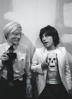 Mick and Andy Warhol at the Factory, October 1977 by Ken Regan.
