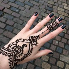 Black mehendi art with matching nail polish