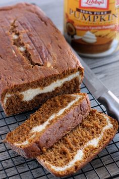 This Cream Cheese Filled Pumpkin Bread is moist and flavorful, but also stunning with that pop of white cream cheese against the orange pumpkin bread. | DessertNowDinnerLater.com #pumpkin #creamcheese #bread #quickbread