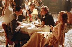"Howard Hughes and Katherine Hepburn dine in a Hollywood nightclub and are interrupted by actor Errol Flynn; Leonardo Dicaprio, Cate Blanchett and Jude Law in Martin Scorsese's ""The Aviator"" (2004)"