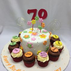 This cake is for a 70th birthday party where the cake is surrounded by cupcakes each with name of the celebrant's children and grandchildren! How lovely!!