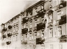 A Jewish man leaps to his death from the top story window of an apartment  block during the suppression of the Warsaw Ghetto Uprising.