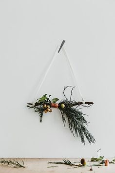 I love the simplicity of these DIY Christmas decorations - an idea for your home this season?     1. Mini Wreath Garland by The Merry Thought. 2. A branch with a simple white candle (Please advise on