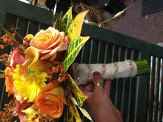 Notice the gems around the wrap of this bridal bouquet.  We always add that extra touch to all our designs.