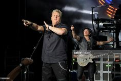 Gary LeVox (L) and Joe Don Rooney of Rascal Flatts performs during the Rhythm and Roots Tour 2016 at DTE Energy Music Theater on September 15, 2016 in Clarkston, Michigan.