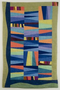 Improvisational stripe quilt in blue and green - note the blue border
