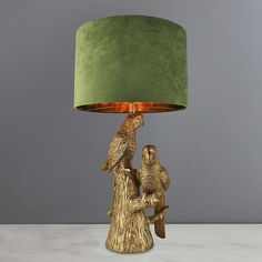 Elegantly fashioned in a stunning gold metallic, this beautiful table lamp features two intricately designed parrots and a khaki green faux velvet taped cylinder shade. Deco Originale, Gold Table, Bedside Table Lamps, Room Lamp, Desk Light, Lampshades, Decoration, Home Decor Inspiration, Parrot