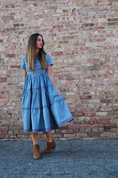 To create a tiered skirt, add layered tiers to your favorite simple dress patterns with these simple steps. Give your garment extra style by stitching on ric rac trim.