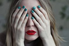 Red lips with teal nails