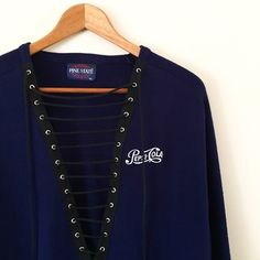 Vintage Pepsi Sweater Navy blue sweater with Pepsi logo embroidered on chest. Altered with lacing down the center. One of a kind!  BRAND: Pine State MATERIAL: 100% acrylic  YEAR/ERA: 90s LABEL SIZE: XL BEST FIT: M  MEASUREMENTS: Chest 22.5 inches Length 26.5 inches  *Listed as LF for views. *Price firm unless bundled.  🚫 Trades 🚫 Modeling 💟 Check out my closet for more vintage! LF Sweaters