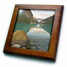 """Alberta, Banff NP, Rocky Mountains, Lake Louise-CN01 LDI0015 - Larry Ditto - 8x8 Framed Tile by 3dRose. $22.99. Dimensions: 8"""" H x 8"""" W x 1/2"""" D. Inset high gloss 6"""" x 6"""" ceramic tile.. Keyhole in the back of frame allows for easy hanging.. Solid wood frame. Cherry Finish. Alberta, Banff NP, Rocky Mountains, Lake Louise-CN01 LDI0015 - Larry Ditto Framed Tile is 8"""" x 8"""" with a 6"""" x 6"""" high gloss inset ceramic tile, surrounded by a solid wood frame with pre-dril..."""