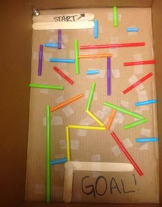 Use a cardboard box, straws and tape to make a marble maze.