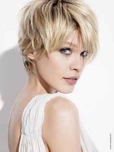 Super jealous of women that can pull off a short haircut like this, and still look super feminine!