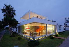Bright Orange Staircase as Focal Point for Casa Blanca Residence in Peru