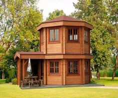 This Pavilion style tiny house is called The Toulouse. It's designed to serve as a luxury garden building. One might also use it as a backyard pool house or guest quarters. Tyni House, Tiny House Cabin, Tiny House Living, Tiny House Plans, Tiny House Design, Yurt Living, Cabin Design, Toulouse, Casa Octagonal
