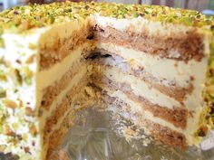 """gimme a hug  In Filipino, this is pronounced """"sans-ree-VAL"""", as in sans rival. It's layers of crisp cashew meringue filled and covered with buttercream and traditionally garnished with chopped cashews. This is a pistachio version."""