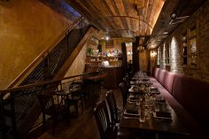 I enjoy the interior of this small NYC pub. With plum seating, restorated wood, and stone walls, it reminds me of something aged, of a great glass of wine, of a creamy pasta or balsamic glaze. To me these colors paired with dimmed warm lighting make me want to eat and relax.