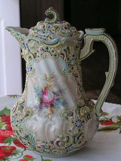 Prussia chocolate pot. this my dears, is why I ADORE  fine china! and old style handpainted dishes.  I have the PRUSSIAN in me!  ;)