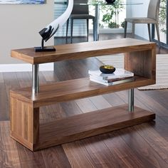 A low unit ideal for TVs or as a contemporary console table, the shelves are separated by chrome pillars giving it a nice contrast. There's ample storage space between them to house anything from digital boxes to DVDs and CDs.