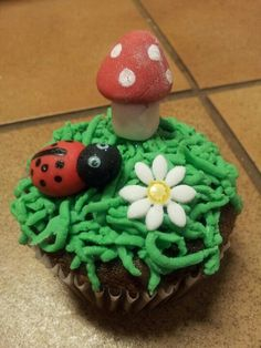 Garden theme cupcake with lady bug and toad stool.