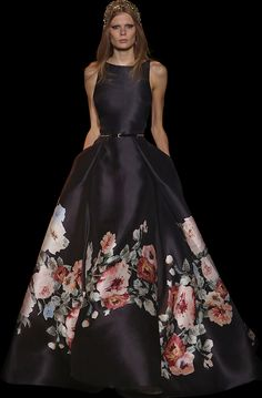Printed silk gazar gown with a deep V-neckline, voluminous sleeves and a full skirt.