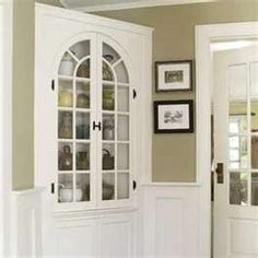 built-in corner cabinet with moulding surround