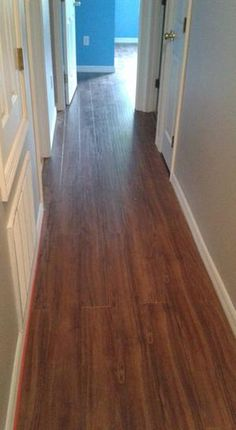 Hampton Bay Hand Scraped Walnut Plateau 8 mm Thick x 5-9/16 in. Wide x 47-3/4 in. Length Laminate Flooring (18.45 sq. ft. / case) HL1003 at The Home Depot - Mobile