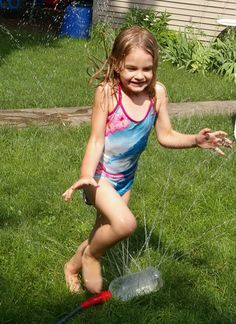 Water fun sprinkler. Simply attach the recycled large bottle with drilled holes all over to the garden hose and then the kids can enjoy great fun in summer to run and jump on it.