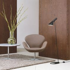 Arne Jacobsen designed the AJ Floor Lamp for the Royal Hotel in Copenhagen. The Jacobsen AJ Floor Lamp's fixture has a white interior that casts light downwards in a soft comfortable light. Arne Jacobsen, Contemporary Floor Lamps, Modern Floor Lamps, Accent Chairs For Living Room, Formal Living Rooms, Swan Chair, Modern Minimalist Living Room, Floor Design, Scandinavian Style