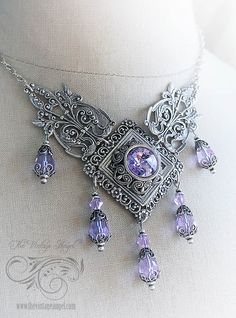 I have spared no detail or expense in creating this amazingly intricate, show stopping necklace.  Aged silver filigree pieces perfectly compliment the orchid purple Swarovski crystals that dance and sparkle on this intricate piece.  Five orchid beaded drops with elaborate bead caps cascade from this necklace, while an orchid hued Swarovski rivoli sits center stage.  Elaborate filigree pieces lead up to fully adjustable chain so you can wear it as a choker or necklace.  Fully